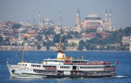 Wonderful sight of a ferry and Hagia sophia in Bosphorus